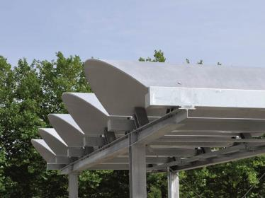 Carbon reinforced concrete today: thin-walled curved barrel shells as roof elements at ITA